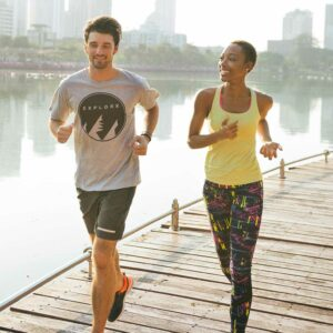 couple running along boardwalk
