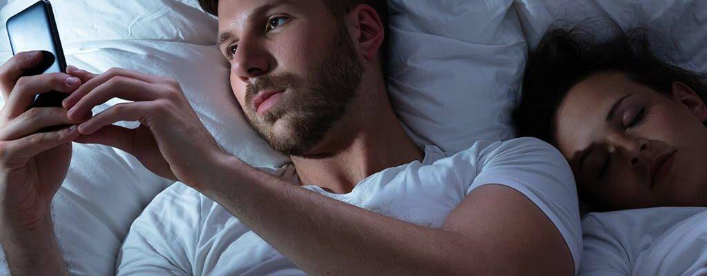 man cheating on sleeping partner